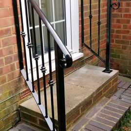 Wrought iron handrail for step