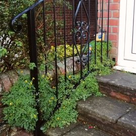 Patterned wrought iron hand rail
