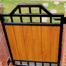 iron gate with wooden panels