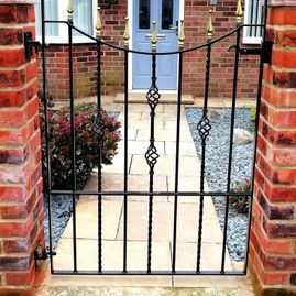 Black and gold iron gate