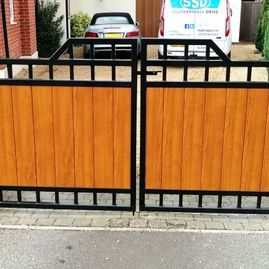 Pair of iron gates with wooden panels