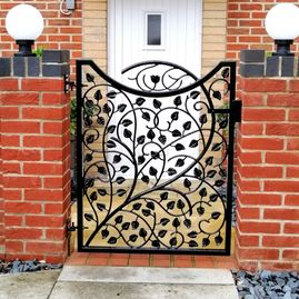 Wrought iron garden gate with leaf design