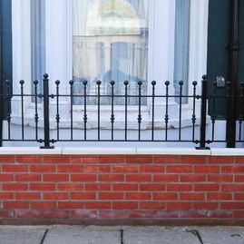 wrought iron railings on wall