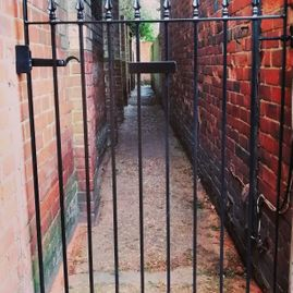 Wrought iron alley gate