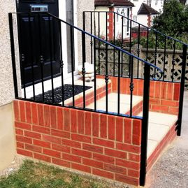Wrought iron handrail on steps