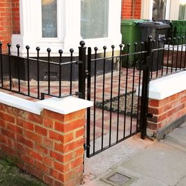 Wrought iron gate with railings
